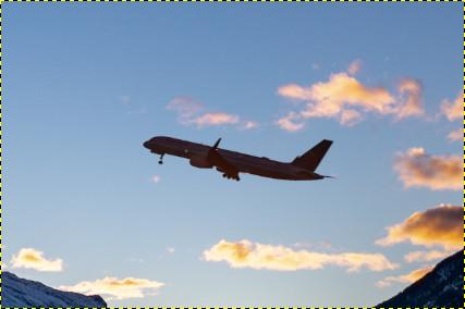 背景画像を追加して合成した飛行機の画像